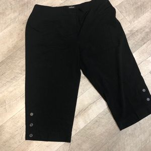 Black capris with button detail